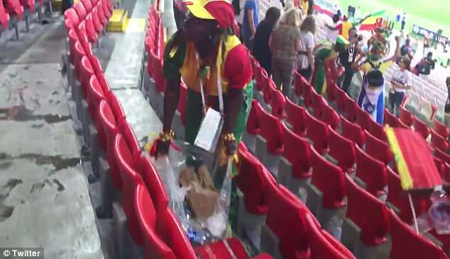 They put their rubbish in the bin bags following the match in a bid to keep the stadium clean