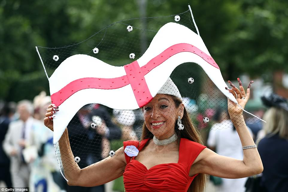 Come on England! A racegoer showed her support for the World Cup footballers by wearing a flag adorned with a net and tiny bejewelled footballs