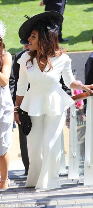 Alexandra Burke opted for a similar look, teamed with an elegant black hat