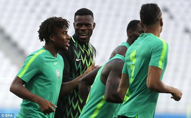 Iwobi shares a joke with Nigeria goalkeeper Francis Uzoho as the squad jogged on Thursday