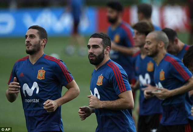 Dani Carvajal (right) and Koke (left) warm up prior to the afternoon's session in Krasnodar