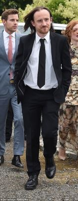 Smart:Ben Crompton, who plays Eddison Tollett on the HBO series, cut a smart figure in a black suit, white shirt and black tie. He styled his signature long locks into a loose hairdo