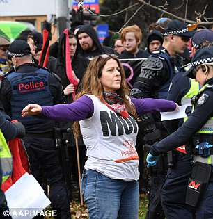 Far-right campaigners escorted by riot police during ...