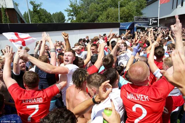 Fans celebrate at Ashton Gate football stadium, Bristol, as a Kane-inspired England tear apart Panama