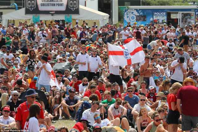 England fans watch the World Cup match against Panama on the big screen at the Isle of Wight Festival back home