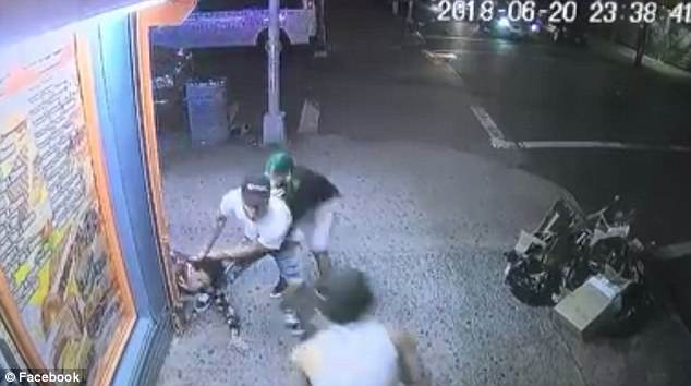 A surveillance video shows a group of suspects pulling Lesandro Guzman-Feliz, 15, out of a Bodega in the Bronx on Wednesday night