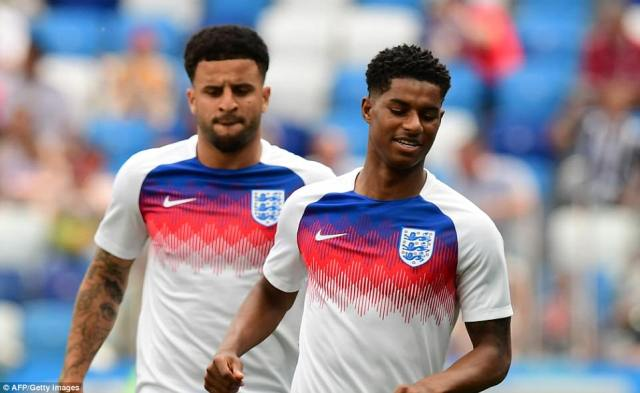 Marcus Rashford and Kyle Walker warm up while fans take their seats in Nizhny Novgorod for Sunday's World Cup match