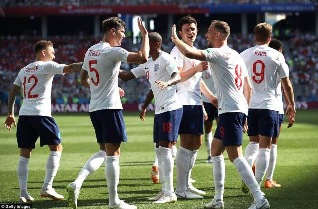 John Stones of England celebrates with teammates after scoring his team's fourth goal against Panama
