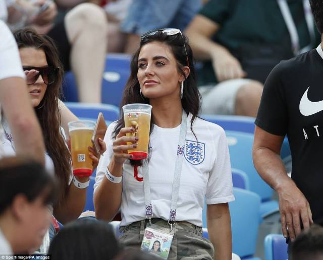 Annie Kilner, the girlfriend of England's Kyle Walker, holds a drink while watching England thrash Panama at the World Cup