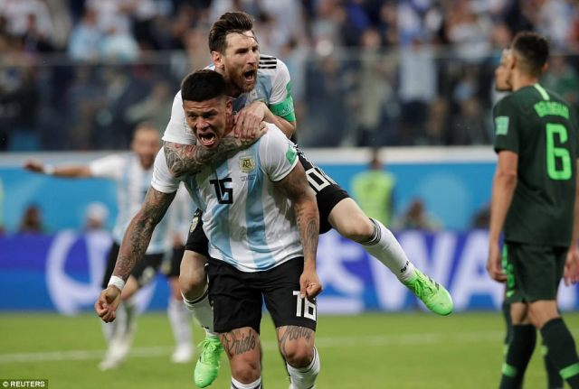 Marcos Rojo celebrated his late winner with Lionel Messi on his back but the striker had carried his team for most of the game