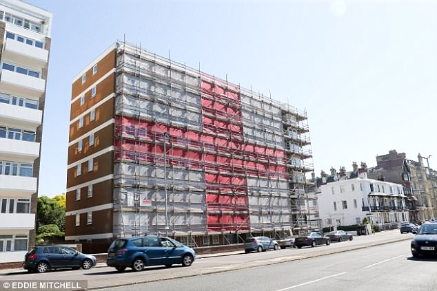 A Seasons Scaffolding team put up an eight-storey flag on Albany Towers in Hove, East Sussex