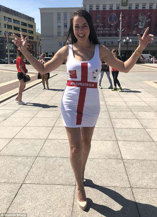Nikki McKenna, 29, donned a dress in the colours of the St George's flag as she looked forward to tonight's match in Kaliningrad