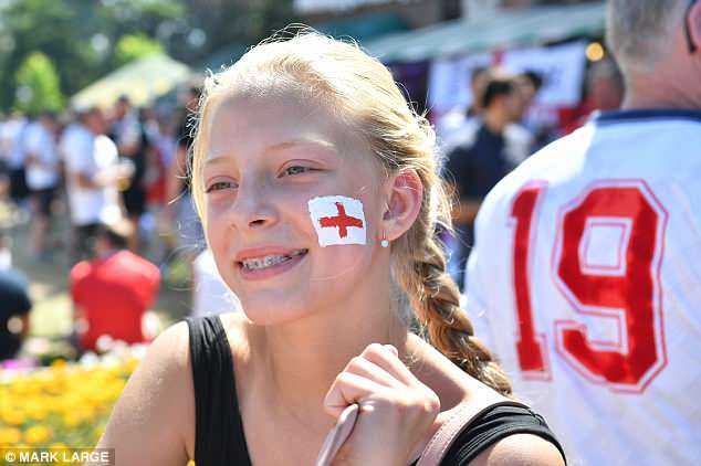 A girl shows off her support for England with a St George's Cross on her face in Kaliningrad
