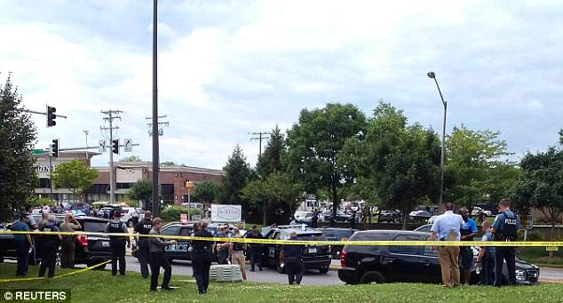 Police officers respond to an active shooter inside the newsroom in Annapolis, Maryland