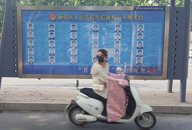 The names, faces and personal details of 30 debtors, referred as 'lao lais' in China, were plastered in large, clear print on bright blue posters at bus stops across the city