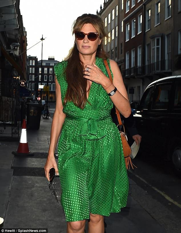Chic style:The British-Pakistani TV producer swept back her glossy brunette locks into a sophisticated half-up'do while stylish tortoiseshell shades shielded her eyes