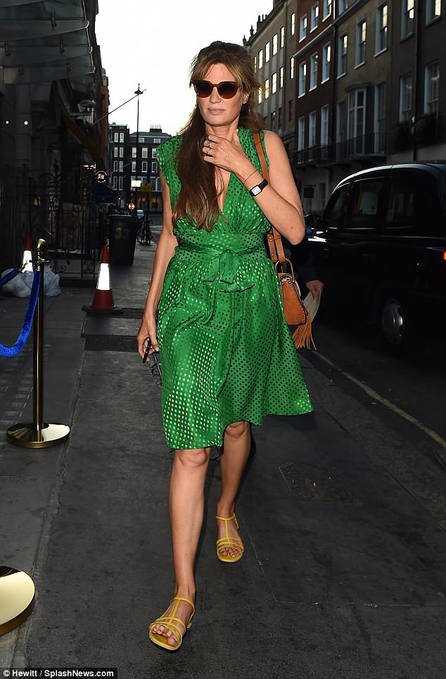 Stepping out: Jemima Goldsmith, 44, put on a glamorous display in an emerald green wrap dress as she dines out in London on Friday