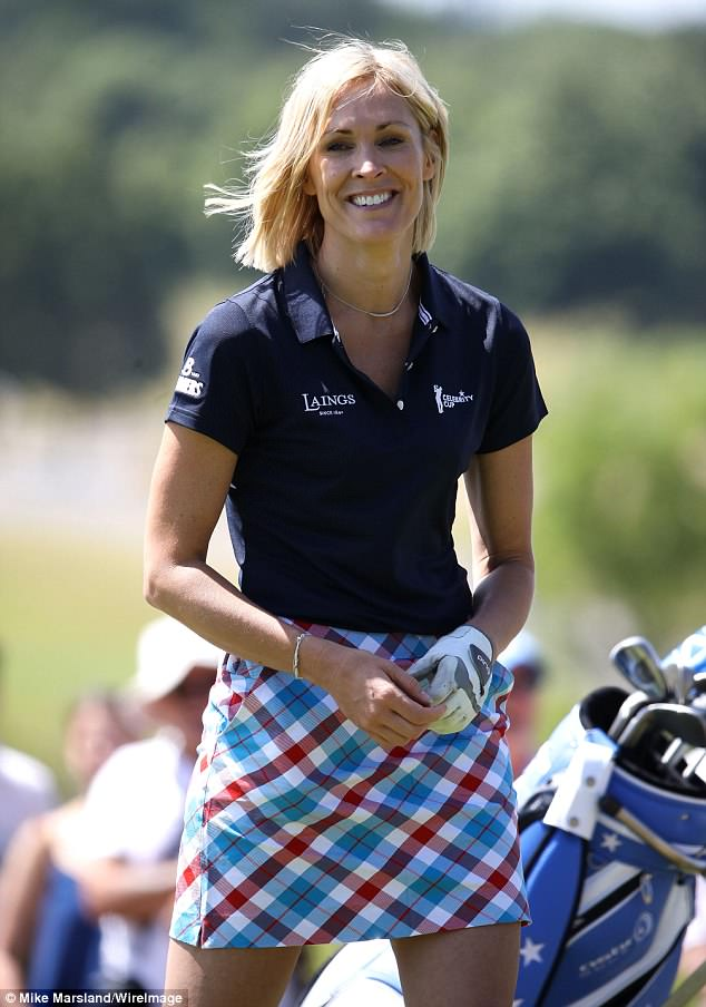 Chic: The 42-year-old TV presenter put on a stylish display in a navy polo shirt and the printed skirt as she headed out onto the green for her shot