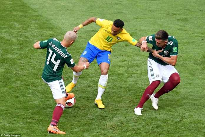 Neymar draws the attention of two defenders as he looks to show his skill and escape from the challenges