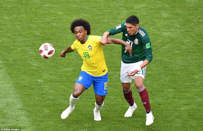 Willian fends off the challenge of Edson Alvarez as the Brazilian winger keeps possession for his side in midfield