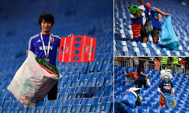 Japanese Fans Clean Up The Stadium After Losing To Belgium