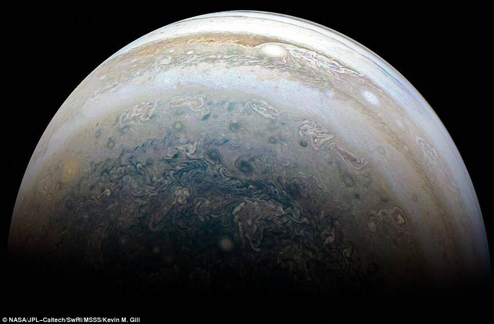 The color-enhanced image was taken at 23:31. PDT on May 23, 2018 (02:31 am EDT on May 24), when the spacecraft completed its 13th near-by fly of Jupiter. At that time, Juno was about 71,300 kilometers from the planet's cloud tops, above a south latitude of 71 degrees
