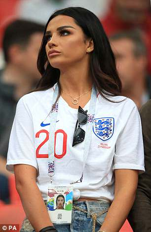 Glamorous: Looking in good spirits as she joined her fellow WAGS in the stands at the Spartak Stadium Stadium, the 23-year-old model showed her support by donning the team shirt