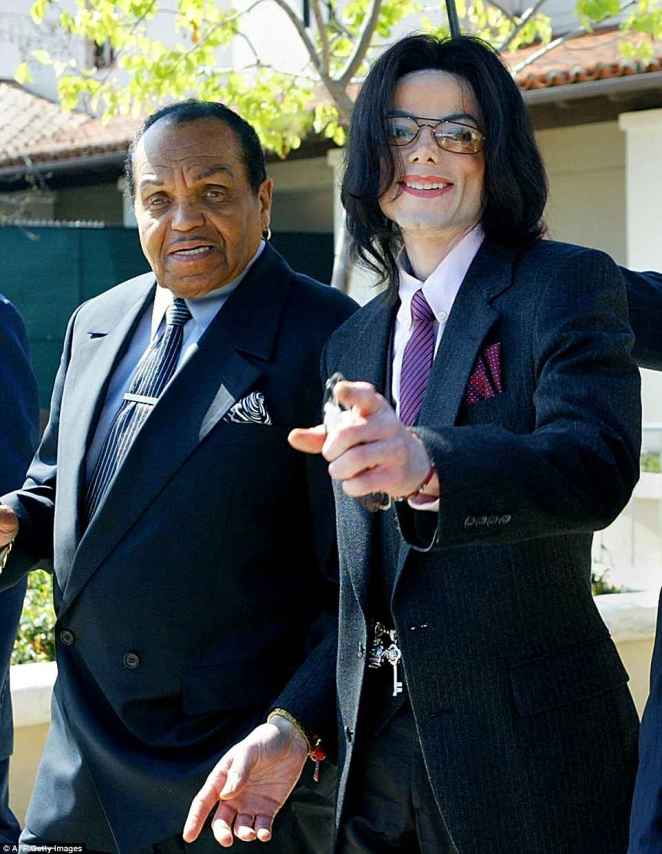 Michael Jackson spoke of being forced to constantly rehearse, and once recalled his father sitting in a chair with a belt in his hand as he and his brothers practiced. The pair are pictured here in 2005