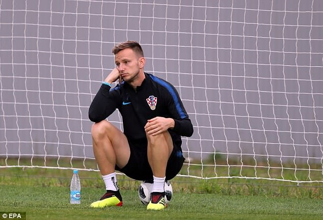 Ivan Rakitic looks on as he takes a break from his preparations for the clash with Russia