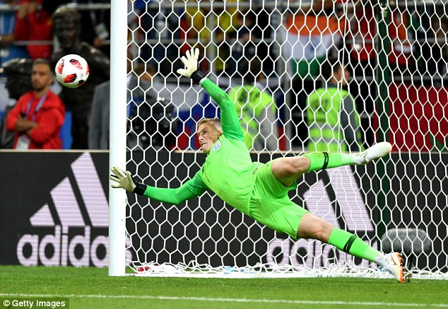 Jordan Pickford dives to save Carlos Bacca's penalty in the shootout, a stop which gave Dier the chance to win it from the spot
