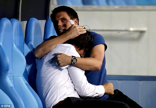 Ognjen Vukojevic (right) comforts Croatia manager Zlatko Dalic, the team assistant has been sacked after posting a 'glory to Ukraine' video