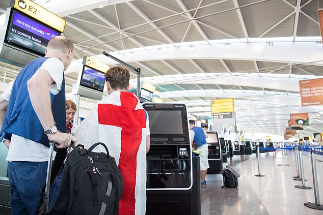 England fans are getting excited for the big match, wearing flags as they check in at Terminal 5 at Heathrow Airport