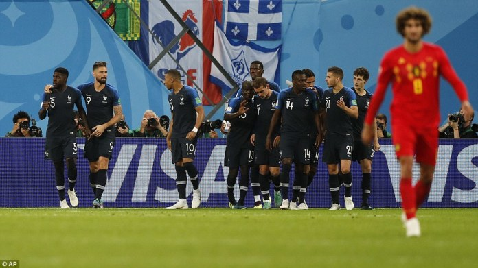 Fellaini trudged back to the halfway line to restart the game as Didier Deschamps' side came together in celebration