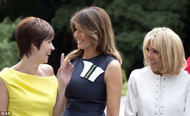 Amelie Derbaudrenghien, the partner of Belgian Prime Minister Charles Michel, left, speaks with U.S. first lady Melania Trump, center, and French first lady Brigitte Macron
