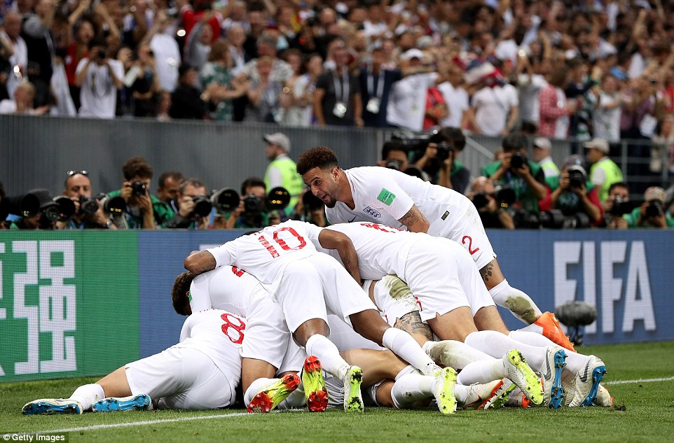 Manchester City star Walker jumps up on top of his England team-mates as they pile on the goalscorer early in the first half