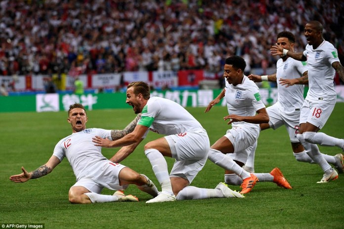 Kieran Trippier is mobbed by his jubilant team-mates after giving England the early advantage against the Croatians