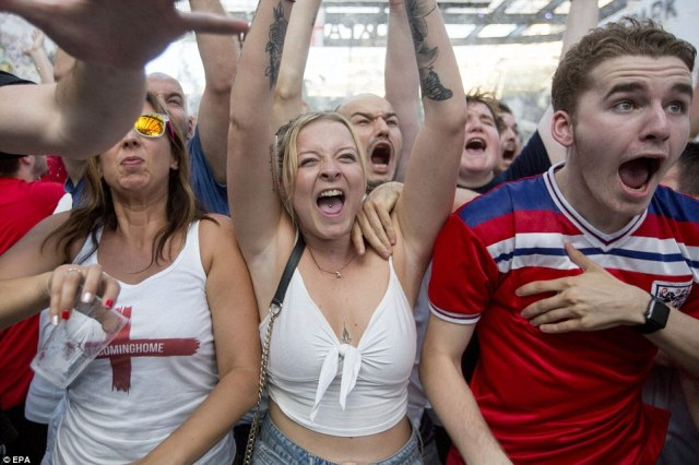 England fans celebrate their team's opening goal as they watch the FIFA World Cup semi final between England and Croatia at BoxPark Croydon inSouth London