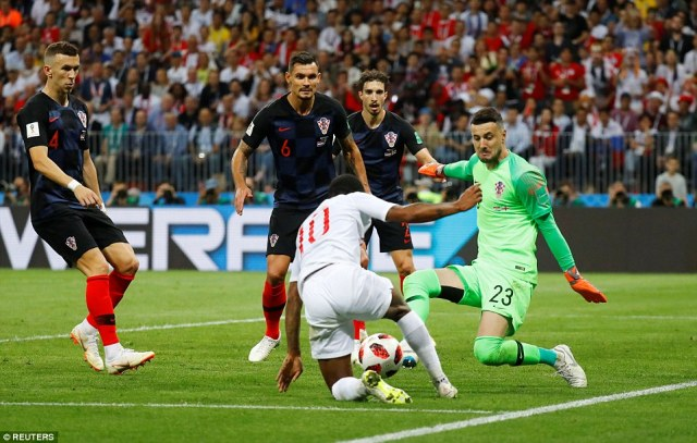 Raheem Sterling goes to ground inside the box as he tries to find a way through for England as Croatia defend in numbers