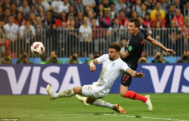 Mario Mandzukic chests the ball down and thumps an effort at goal but it is straight at England goalkeeper Jordan Pickford