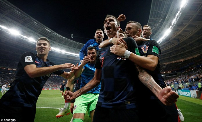 The Croatian players rush to congratulate the match-winner Mandzukic as they head to their first ever World Cup final