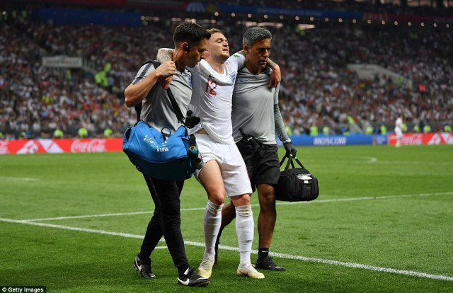 Kieran Trippier is helped off the pitch by England physios after suffering a muscle injury late into extra-time