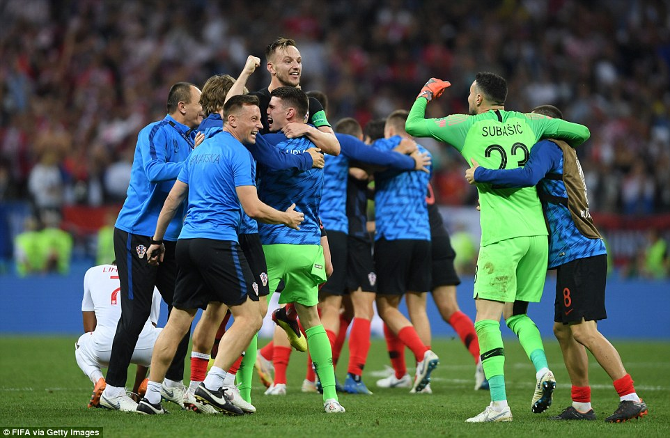The Croatian players celebrate at the end of the game after reaching a first ever World Cup final, where they will face France