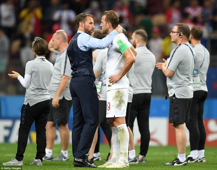 The England boss puts his arm around England captain Harry Kane as they thank the fans for their support out in Russia