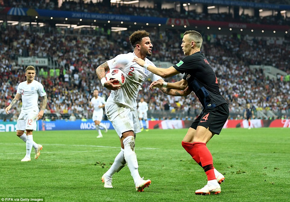 Croatia winger Perisic grapples with England defender Walker and tries to get the ball off him to restart play in Moscow