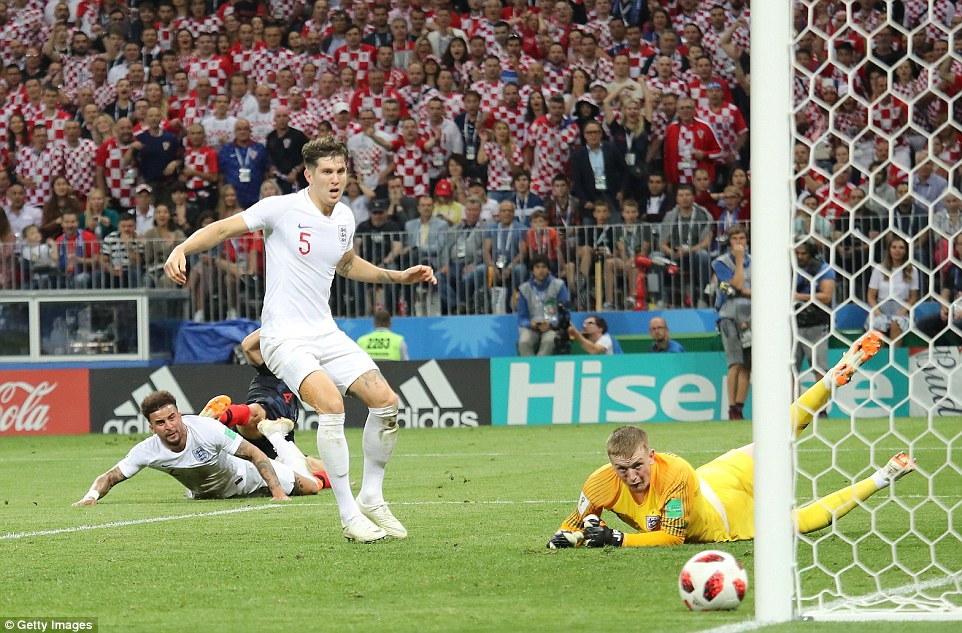 Walker, Stones and Pickford can only watch as Perisic's effort hits the foot of the post for Croatia minutes after the equaliser