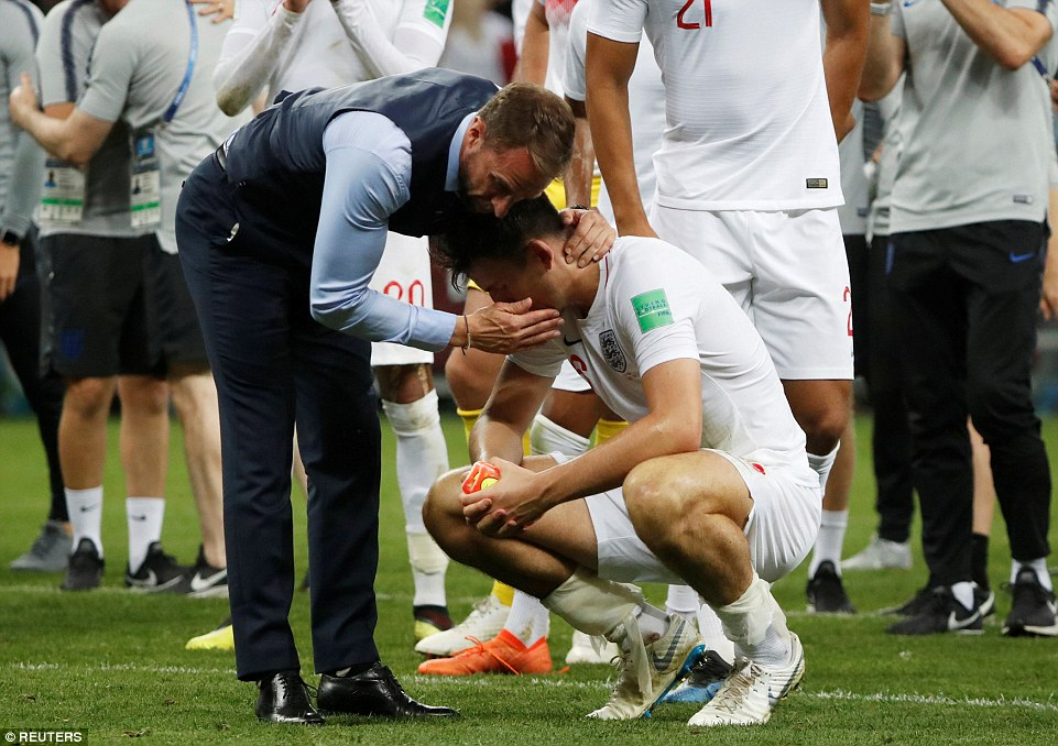 The England boss consoles defender Harry Maguire after Three Lions crashed out of the World Cup at the Luzhniki Stadium