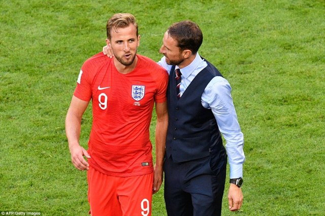 Boss Gareth Southgate puts his arm around star striker Harry Kane after beating Sweden and the nation will watch them with excitement and trepidation tonight