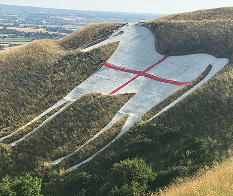 The ancient Westbury White Horse in Wiltshire has even been turned into an England flag