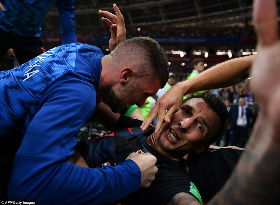 Mandzukic had grabbed hold of Cortez but was sent tumbling by his jubilant team-mates, and as the photographer was sent spinning down to earth, he continued to take pictures
