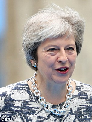 The PM is battling for her political career as mutinous Eurosceptic Tories have launch coordinated resignations and are mobilising to kill off her Brexit plans.